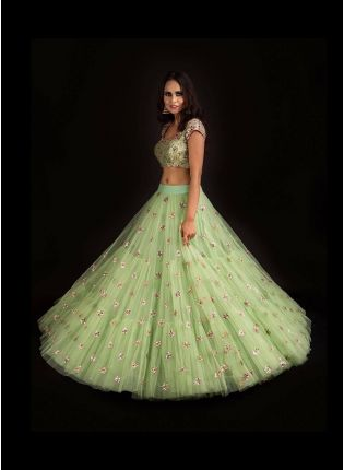 Party Wear Pista Green Color Soft Net Base Ruffle Lehenga Choli