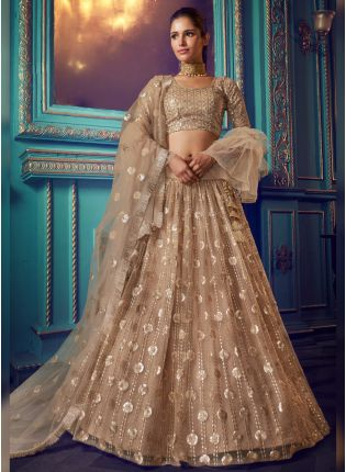 Modish Beige Colored Soft Net Sequin And Zari Work Ethnic Lehenga Choli