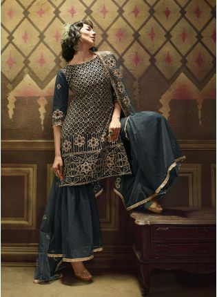 Emerald Green Soft Net And Sequins Sharara Salwar Suit.