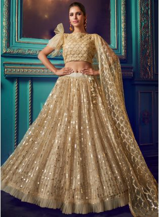 Admirable Beige Colored Soft Net Sequin And Zari Work Lehenga Choli
