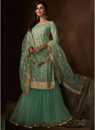 Phenomenal Pale Green Soft Net Festive Wear Flared Sharara Suit