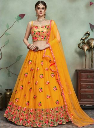 Delightful Yellow Color Soft Net Base Heavy Thread And Sequins Work Lehenga Choli