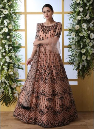 Sensational Peach Colored Soft Net Base Festive Wear Designer Gown