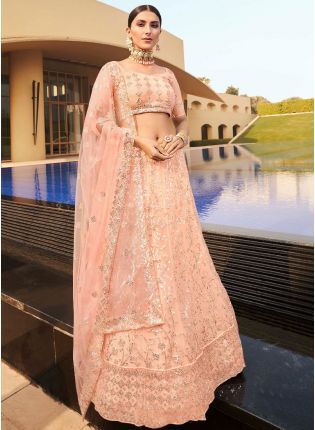 Enticing Peach Color Soft Net Base With Sequins Work Lehenga Choli