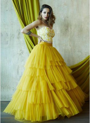 Fashionable Lemon Yellow Ruffled Lehenga Choli With Zari Work
