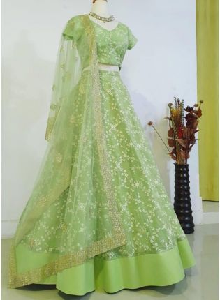 Mesmerizing Pista Green Soft Net Base Resham Work Lehenga Choli