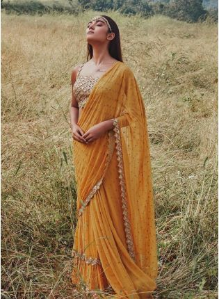 Trendy Mustard Yellow Color Georgette Base With Heavy Work Designer Saree