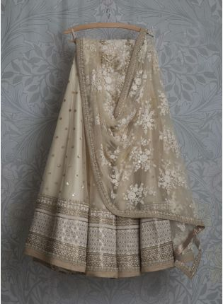 Glamourous Wedding Wear Beige Net Lehenga Choli