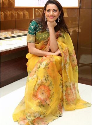 Decent Yellow Color Organza Base Saree With Green Blouse
