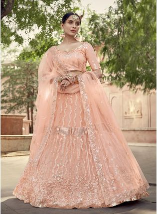 Enthralling Peach Soft Net With Matching Blouse and Dupatta Set